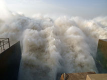 The outlet of the Merowe hydroelectric power station. Masses of water spilling out the dam of the hydroelectric power station in Merowe, Sudan. This is the Stock Photos