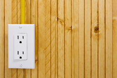 Outlet on a wooden wall Stock Photos
