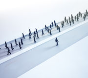 Outlier choosing his own path. An outlier choosing his own path - tiny people walking in different directions Stock Photos