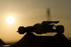 Outline of classic racing car. With sunset in background Stock Photography