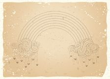 Vintage rainbow and clouds background. Outline clouds and rainbow on old paper background. Hearts and rain. There is copy space for your text Royalty Free Stock Photo