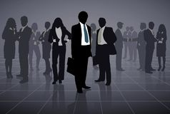 Outline of a group of business people on a black background royalty free stock photos