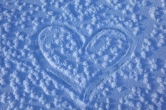Outline of heart. On snow stock image