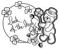 Outline round frame with shamrock contour and teddy bear. Raster clip art. Contour round frame with shamrock, teddy bear and artistic written text `Luck of the stock photography