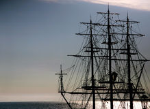 The outline of a sailing ship. In the sea Royalty Free Stock Photo