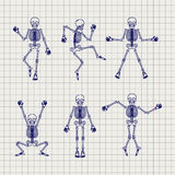 Outline skeletons set on notebook page Stock Photography