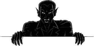 Outline of a vampire holding up a sign Royalty Free Stock Images