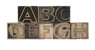 Outline wood type. Old, inkstained letterpress wood outline type letters A-H royalty free stock images