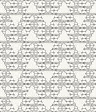 Outlined abstract textile background with irregular structure of repeating triangles Royalty Free Stock Photo