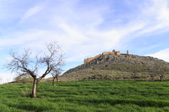 Outlined on a hilltop are the ruins of the Castle of Xiquena Stock Photo