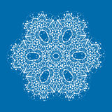 Outlined mandala on blue background. Vintage Royalty Free Stock Images