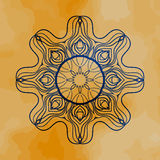 Outlined mandala over henna colored old paper Stock Photos