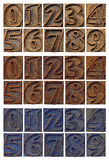 Outlined numbers in letterpress wood type blocks. Isolated outlined numbers in letterpress wood type blocks- three sets with different wood stain Stock Image