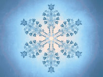 Outlined representation of a snowflake on a blue background Stock Photo