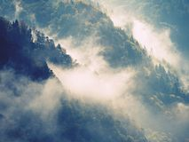 Outlines of forest hills hidden in thick mist. Unclear view to contours of hills Royalty Free Stock Photography