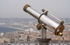 Outlook. A spy glass over a historical european town Stock Photos