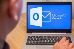 Free Outlook Is Used By A Man On The Laptop. Microsoft Customer Used Computer Software. New Product Is Tested By IT Specialist. San Royalty Free Stock Photography - 173993337