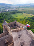 An outlook from the Lubovna castle, Slovakia. A great outlook from the Lubovna castle, Stara Lubovna village, Spis region, eastern Slovakia. A waving flag of royalty free stock image