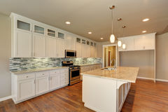 Outlook at the luxury modern kitchen in a brand new house. Royalty Free Stock Image