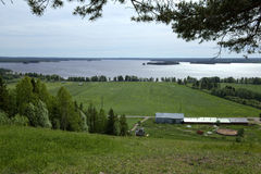 Outlook over agricultural landscape and lake at Stroemsund, Sweden Royalty Free Stock Photo