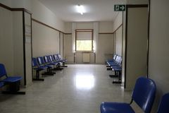 Outpatient clinic corridor. Empty with chairs Royalty Free Stock Photography