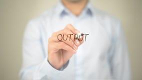 Output , Man writing on transparent screen Stock Photo