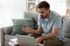 Outraged angry man reading bad news, having problem with laptop. Outraged angry man reading bad news, looking at screen, having problem with broken laptop royalty free stock photography