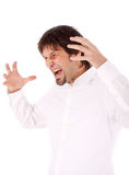 Outraged businessman. Screaming and pointing his hands towards his head Royalty Free Stock Photo