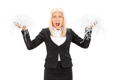 Outraged businesswoman holding a shredded document Stock Images