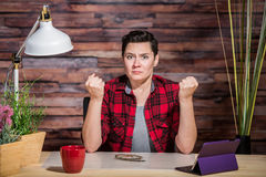 Outraged Woman with Clenched Fists Royalty Free Stock Images