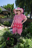 Outrageous Gardener. Humorous image of a gardening granny in her garden royalty free stock photography
