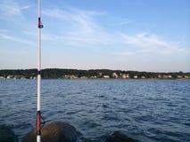 Outre de la pêche de rivage Photographie stock