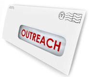 Outreach Word on Envelope Message Advertising Communication. Outreach word on an envelope mailed to an audience to persuade with a message of advertising or Stock Photography