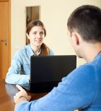 Outreach worker with laptop. Man  answer questions of outreach worker with laptop in home or office Stock Image