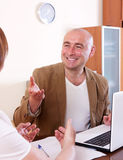 Outreach worker with laptop Royalty Free Stock Photo