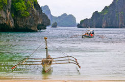 Outrigger Boat in Lagoon Stock Images