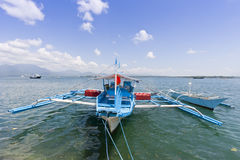 Outrigger boat moored at wharf Stock Image