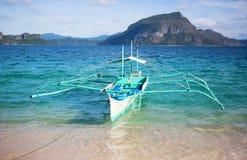 Outrigger boat near the shore on Palawan Stock Photos
