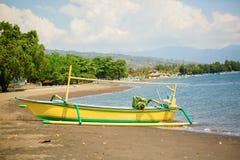 Outrigger boat ot the beach in Lovina, Bali Royalty Free Stock Image