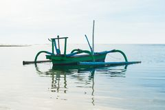 Outrigger boat with reflection Stock Image
