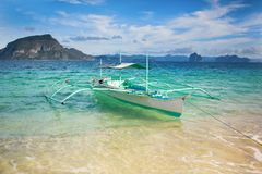 Outrigger boat on a tropical beach Stock Photo