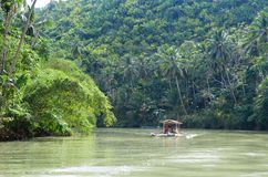 Outrigger boat on a tropical river Royalty Free Stock Photography