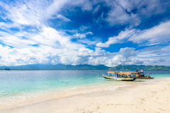 2 outrigger boats on a beautiful white sand beach Stock Photos