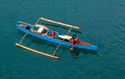 Filipino Woman Paddling Her Outrigger Canoe Royalty Free Stock Image