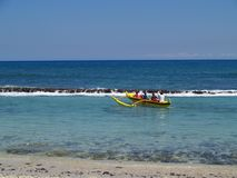 Outrigger Canoe. Family in an outrigger canoe off a beach in Hawaii Royalty Free Stock Image