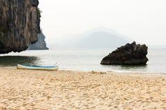 Outrigger canoe on the beach Stock Photo