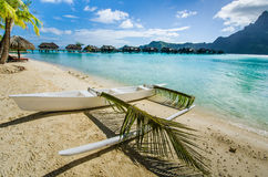 Outrigger canoe on the beach in the tropics Royalty Free Stock Photo