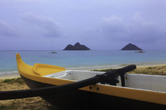 Outrigger canoe on a hawaii beach Stock Photos