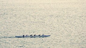 Outrigger Canoe Team Rowing near Lahaina, Hawaii Stock Photo