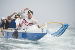 Outrigger Canoeing Team In Race Stock Image